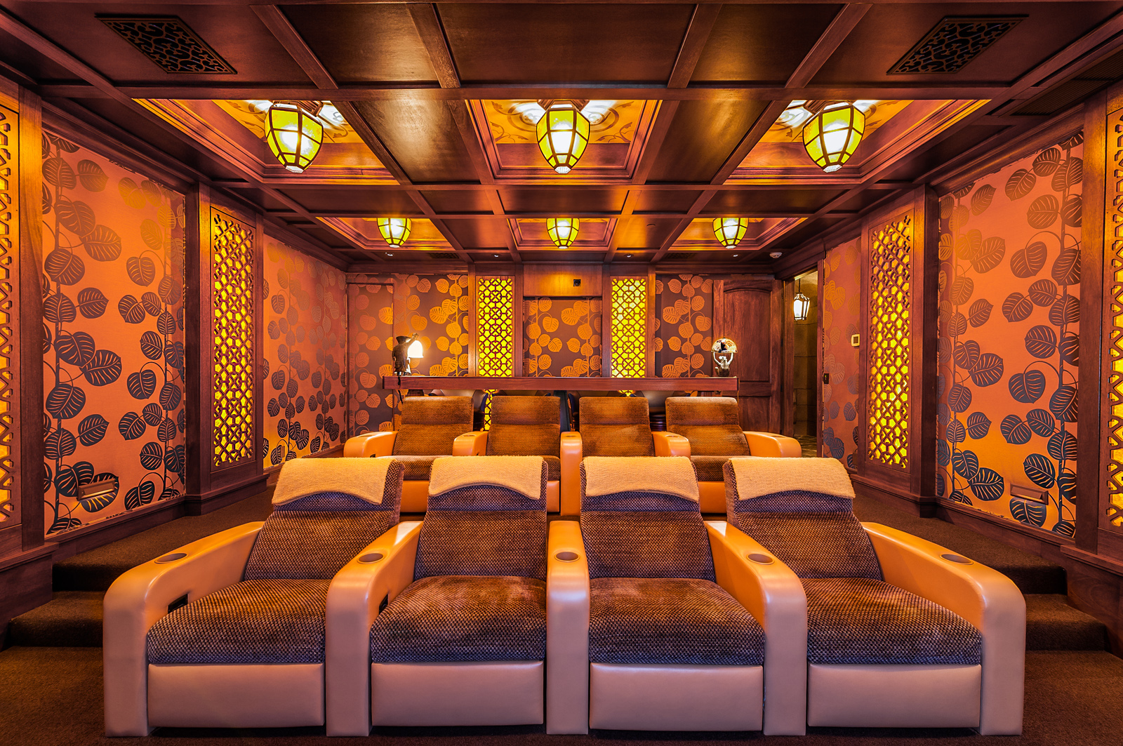 Craftsman style home theater with acoustical wall panels and custom lighting